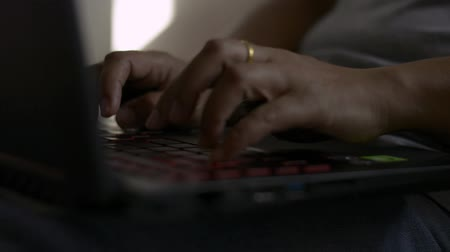 Hands of woman typing on computer keyboard, Businesswoman working with laptop on the bed. Stock Footage