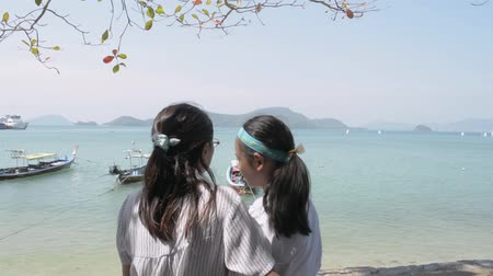 Mother and her daughter watching the beautiful scenery of the pier in phuket. Expression of love between mother and daughter. Stock Footage