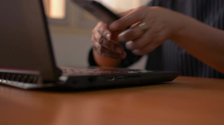 Hands of woman typing on computer keyboard and using mobile phone, Businesswoman working on laptop in office, Office life. Stock Footage