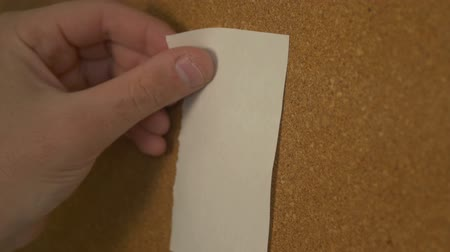 talep : Pinning a paper on cork board
