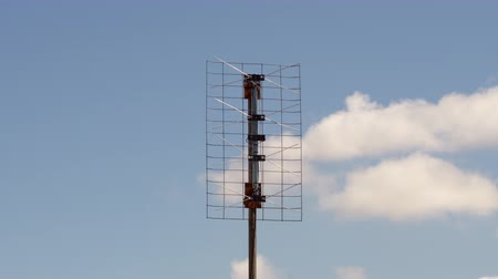 Medium shot of Home digital tv antenna based cloudy day time lapse with no birds in it. Wideo