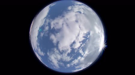 Fisheye wide angle shot of clouds during daytime resembling planet earth, no birds in it.
