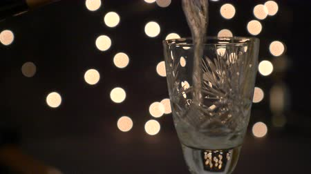 Close up of a glass overflowing with Champagne when it is served Wideo