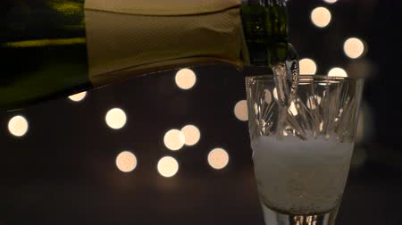 Close up of a glass with champagne served in nightime