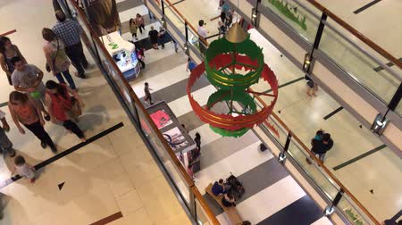 People Christmas shopping at three levels in Buenos Aires shopping mall