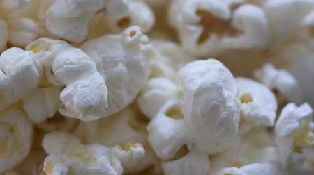 Macro shot of a bowl of popcorn spinning