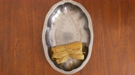 Overhead shot of a tray filled with tamales for serving