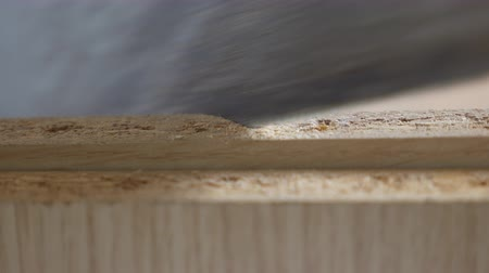 Sawing two wooden blocks close up shot