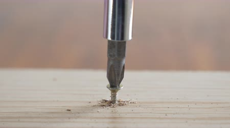 Drilling to screw into wood close up shot