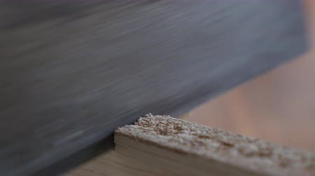Sawing one wooden block close up shot