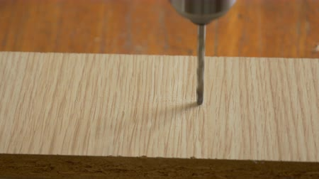 Drilling wood with power drill close up