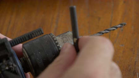 Putting on a wick on a drill close up shot