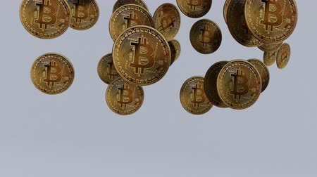 Close up shot of Bitcoins falling down in slow motion