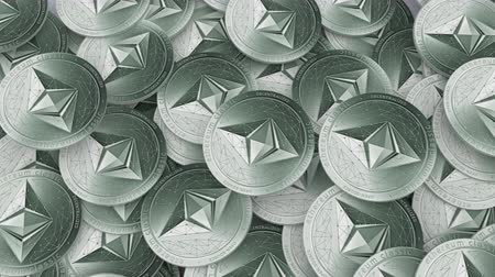 Close up shot of large amount Ethereums classic cryptocurrency on a table