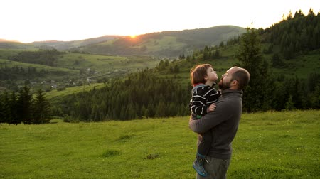 Son with father on mountain Стоковые видеозаписи