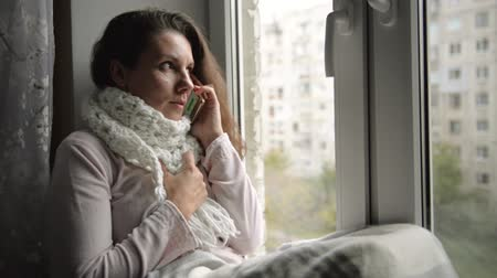 Flu sick unhappy young woman calls the doctor. Calling the doctor at home Стоковые видеозаписи