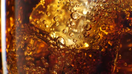 coque : Cola with ice background. Large glass of cold coke with ice cubes close-up. 4k