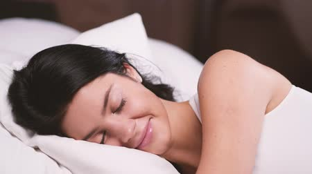 kısa : Attractive young girl at home. Sleeping in her bed