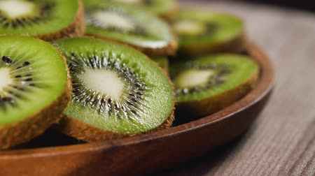 picked : Heap of fresh sliced kiwi fruits rotating on the plate. Closeup macro shot. Fresh berry series. 4k. Stock Footage