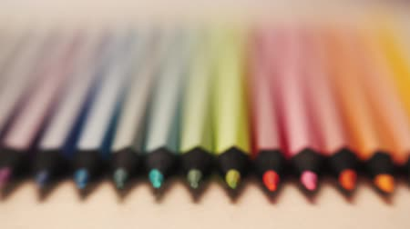 bilenmiş : Colorful wooden pencils on wooden background. Sliding focus. Shallow DOF. Macro shot. Stok Video