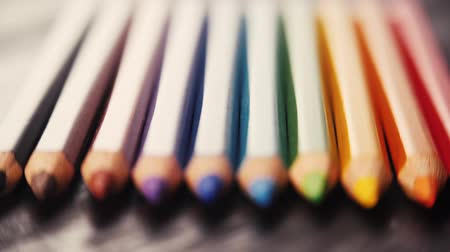 takip etmek : Colorful wooden pencils on wooden background. Sliding focus. Shallow DOF. Macro shot. Stok Video