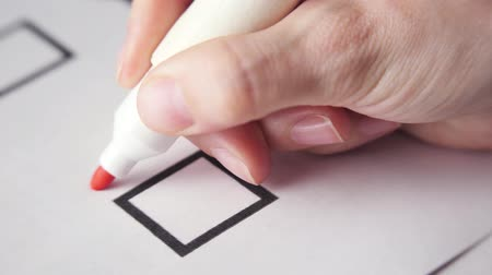 Marking checkbox with no. Red pen or marker. Elections or voting. Wideo