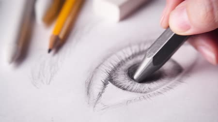 Artist drawing eye with a big graphite pencil. 4k.