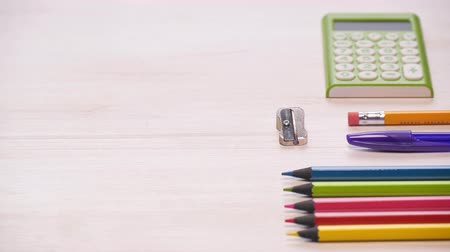 Stop motion shot of a school desk with different colorful supplies. Supplies are showing up. 4k.
