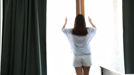Girl open window at my bedroom in the morning.