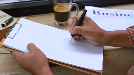 segregatory : Business manager writing on white paper.