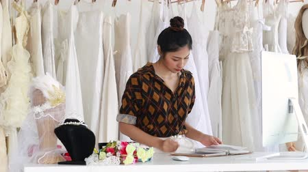 Young woman of bridal store owner waiting for customer