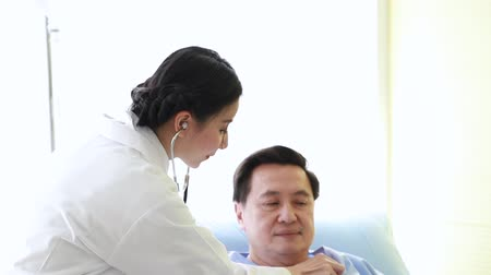 Medical professionals woman reassuring and talking with patient.