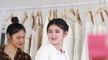 white cloths : Young woman measuring on wedding dress in a shop by the tailor.