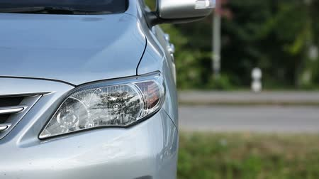wayside : headlight front of modern vehicle car automotive