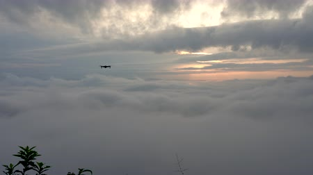 the mekong : Drone flying on the foggy during sunrise Stock Footage