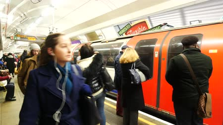 mind the gap : LONDON, UNITED KINGDOM  22 JANUARY 2016: People commuting via  tube underground train in London on January 22, 2016. London Underground carried over 1 billion passengers per year.