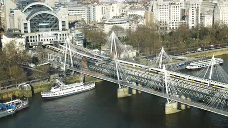london england : LONDON, UNITED KINGDOM  25 JANUARY 2016: Aerial view of Hungerford Bridge and Golden Jubilee Bridges, London City and River Thames in UK