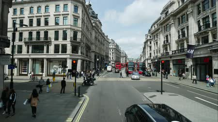 covent : LONDON, UNITED KINGDOM - MAY 20, 2016: Time lapse of traffic at the shopping center of London taken from the double deck bus on May 20, 2016 in London, United Kingdom.