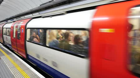 mind the gap : LONDON, UNITED KINGDOM - 21 MAY 2016: People commuting via  tube underground train in London on May 21, 2016. London Underground carried over 1 billion passengers per year.