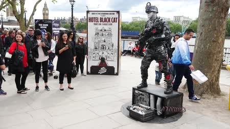 covent : LONDON, UNITED KINGDOM - 23 MAY 2016: The human robotic street show on the street along the river Thames in London, United Kingdom