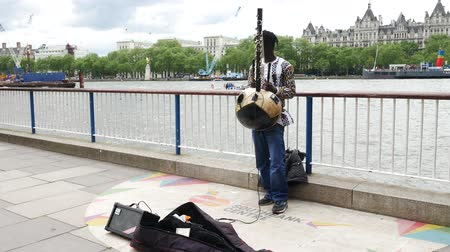 covent : LONDON, UNITED KINGDOM - 23 MAY 2016: The musician performing African music on the street along the river Thames in London, United Kingdom