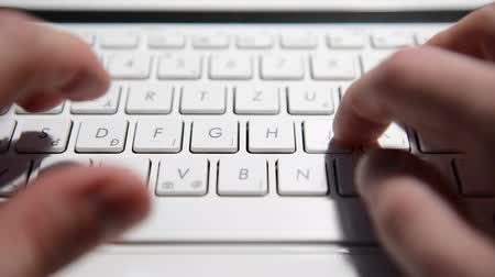 marketing : Hands typing text on a laptop keyboard closeup