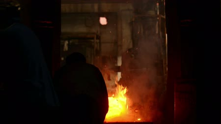 metallurgic : Industrial workers at the factory creating iron Stock Footage