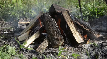 inflammable : Camp fire outdoors burning with logs