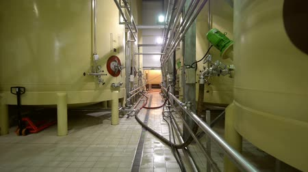 ipari : Industrial interior with welded silos angle shot