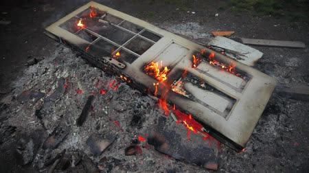 consumir : Door burning outdoors on the ground Stock Footage