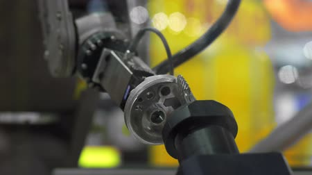 automate : Robot arm holding car part closeup footage Stock Footage