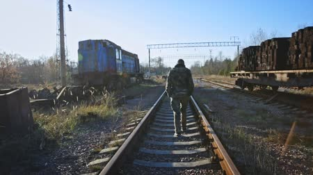 Man walking on railway