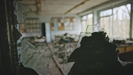 doorway : Broken glass at Chernobyl school closeup footage