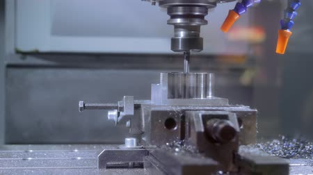 fabryka : Steel car part being produced by robot drill